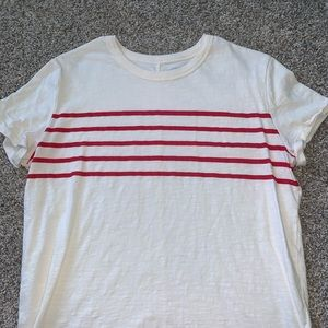 casual white tee with red stripes across chest